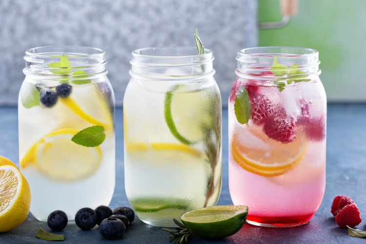 Fruit-infused water recipes bursting with flavor and the perfect way to stay hydrated. Fruit water is so easy make and the perfect way to make sure you are drinking enough water every day. Kids love these fruit water recipes too! | ezebreezy.com