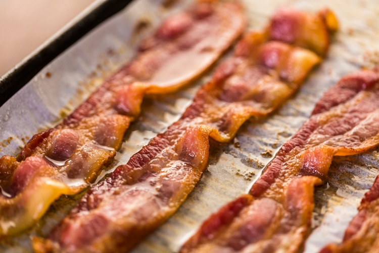 The BEST way to cook perfect bacon is in the oven. Crisp & golden brown - oven baked bacon is the way to go. Practically mess-free and ready in under 20 minutes   www.ezebreezy.com   #bacon #perfectbacon #recipe